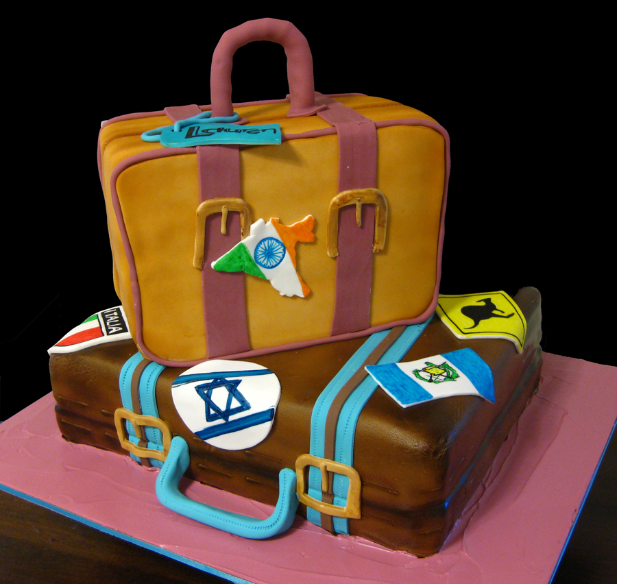 Travel themed sculpted suitcase cake