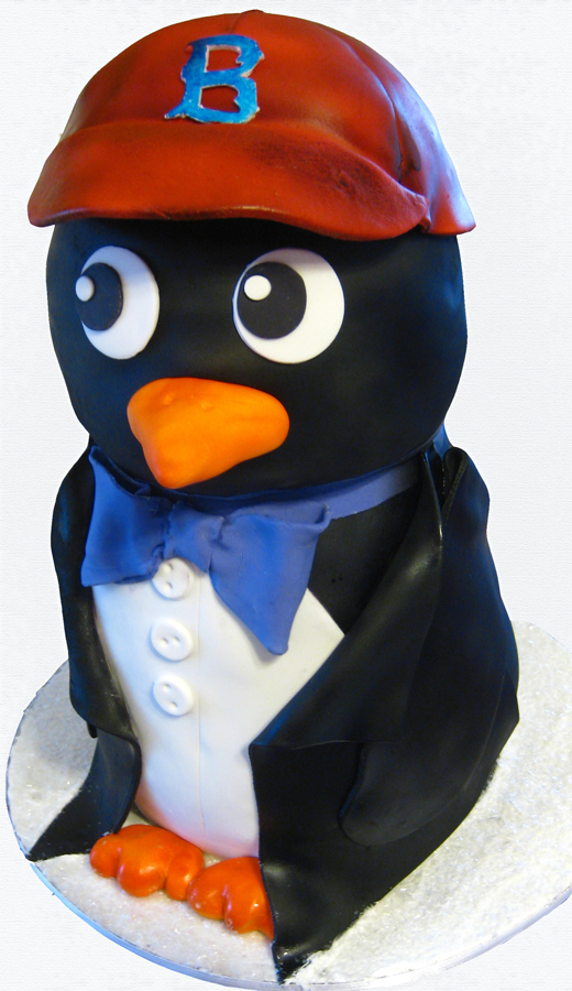 Sculpted penguin cake with Red Sox hat