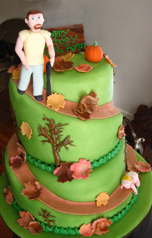 father and son hill with fall leaves cake